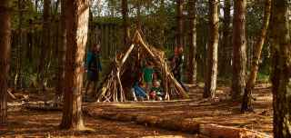Family enjoying the Den Building and Decorating activity