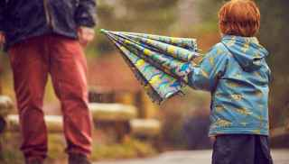 Young boy with his dinosaur umbrella
