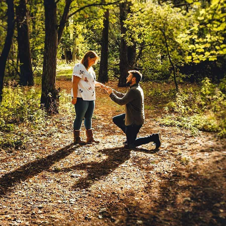 Man proposing to his partner in the forest
