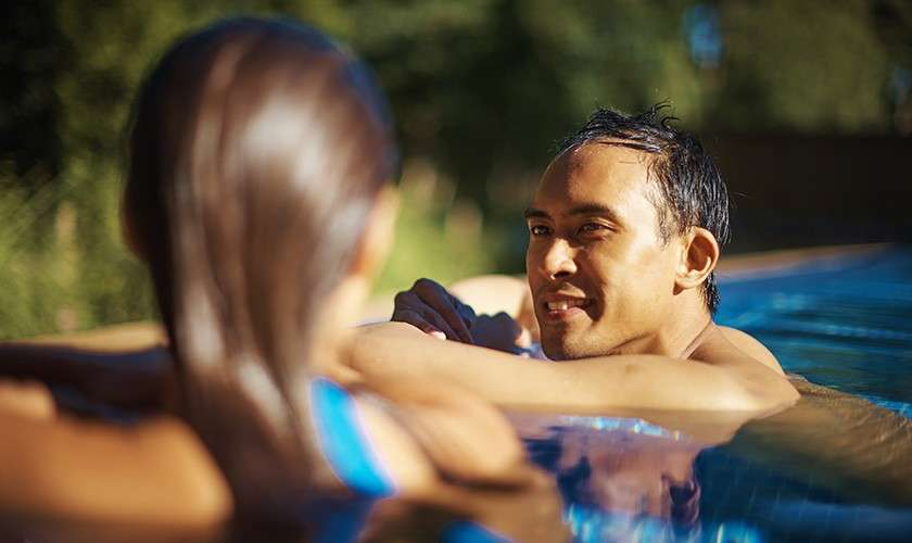 Couple relaxing in an outdoor pool at Aqua Sana Spa