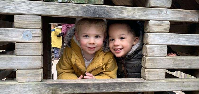 2 boys at the outdoor play area