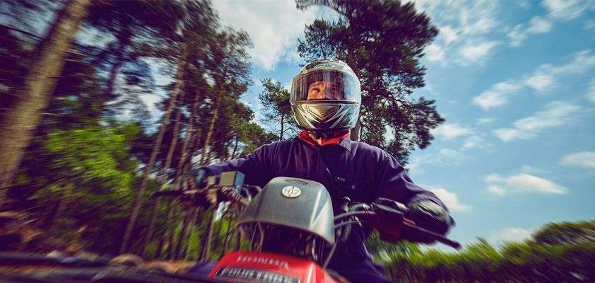 Man on quad bike in forest