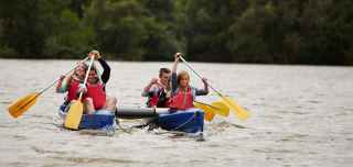 Family kayaking on a Center Parcs lake