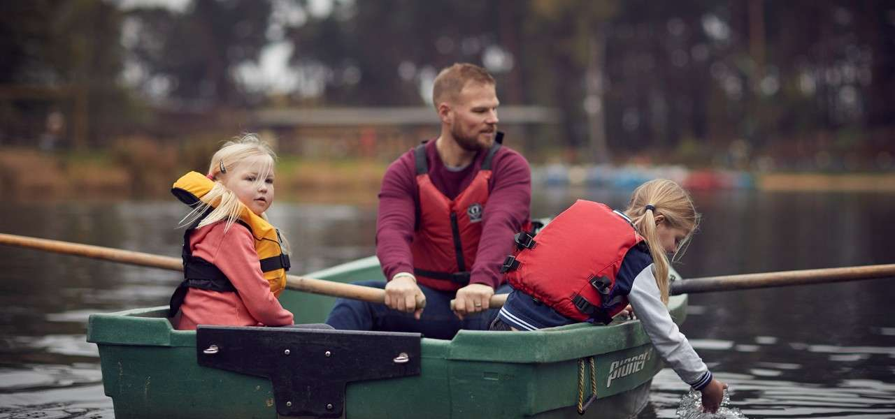 Family in a rowing boat on the lake