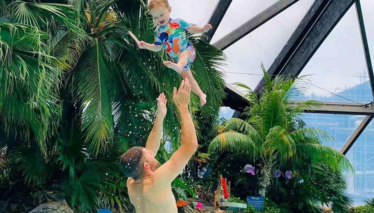 Father throwing child in the air in the Subtropical Swimming Paradise