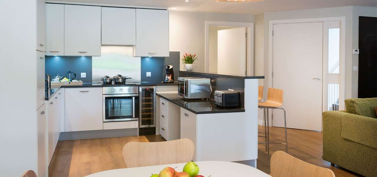 Adapted lodge kitchen with lowered worktops