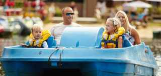 Family on a pedalo on a Center Parcs lake