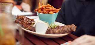Rack of ribs with a side of sweet potato fries from a Center Parcs restaurant